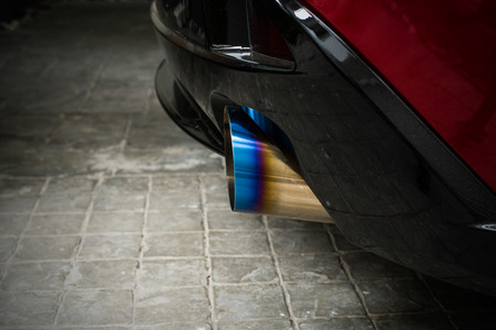chromed: Sportive mufflers. Round Car Exhaust Pipe chromed made of stainless steel with flame burned tail