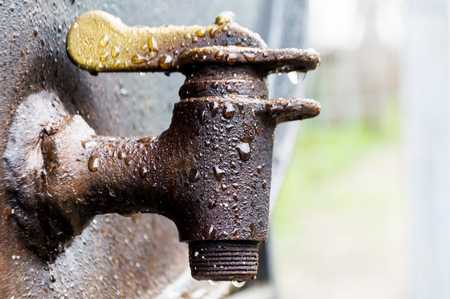 Close up on a rusted faucet Stock Photo