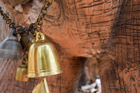 rin gong: the gold bell hang on the chain under the elephant statue Stock Photo