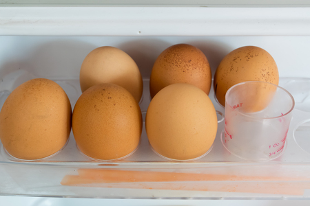 refrigerate: egg, shelf, cold, electric, kitchen, white, keep, brown, cooler, freezer, plastic, door, beige, easter, healthy, cool, cook, ingredient, health, hen, food, fridge, refrigerator, refrigerate Stock Photo