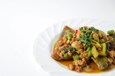 stir fired minced pork with basil top on fired preserved egg