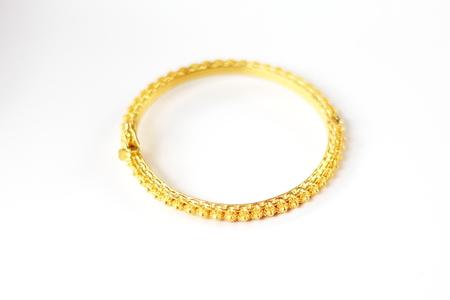 Gold bracelet isolated on white background. Stock Photo