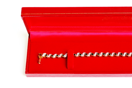 Golden bracelet and Gem with red velvet box,Isolated on white background.