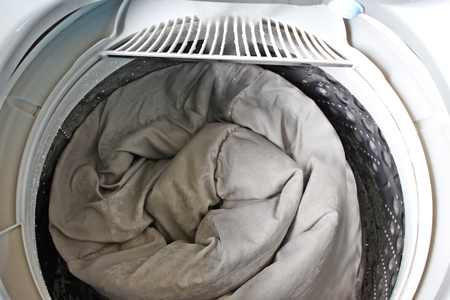 Roll up the duvet put in a washing machine.