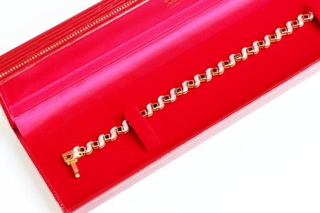 Golden bracelet and Gem with red velvet box,Isolated on white background.
