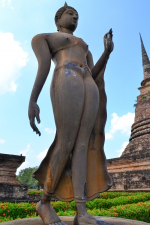buddha  on ruins temple in Sukhothai historical park  thailand photo