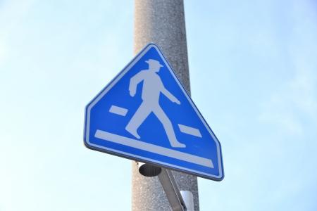 across sign photo