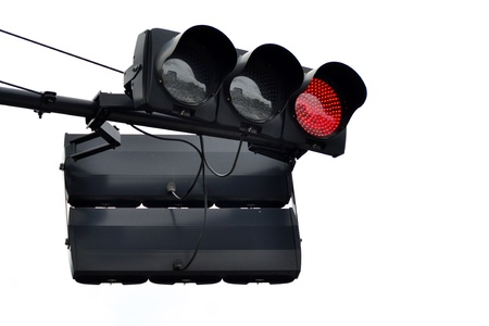 Red traffic light on white background photo