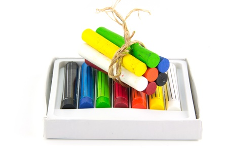 A white box of colored crayons  photo