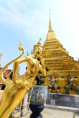 glorify: The golden Thai fairy bird on half human at Wat Phra Keaw, Thailand Stock Photo