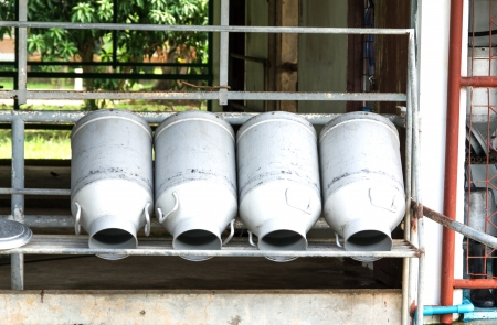 milk cans: Milk cans on a shelf