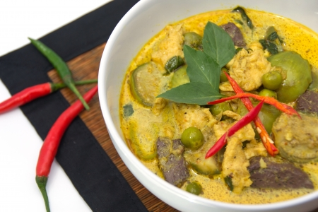 thai Green Curry with Chicken in a white bowl photo