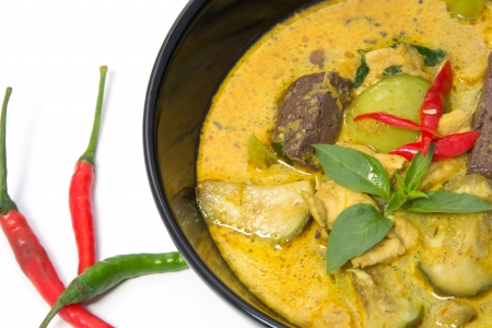 Thai Green Curry with Chicken in a black bowl photo