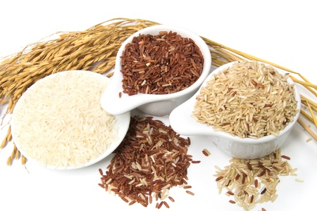 Assortment of rice in white background photo