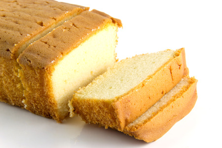 pounds: Butter cake and slices on whiye background
