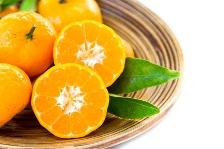 Fresh juicy tangerines in bowl photo