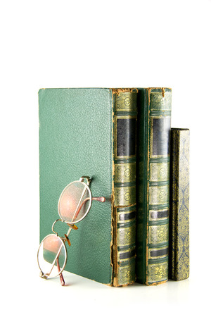 vintage books stacked and glasses photo