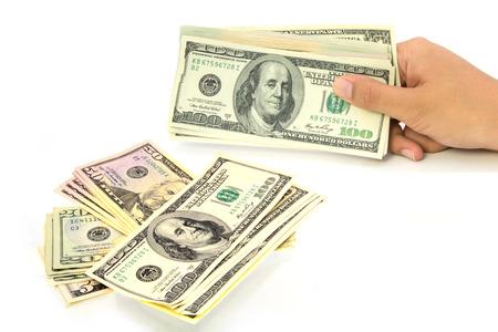 Hand holding money dollars isolated on white background photo
