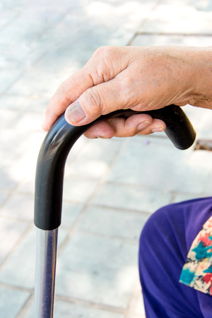 the ageing process: Older woman Holding Walking Stick Stock Photo