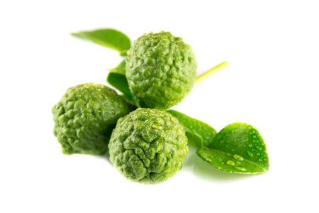 Fresh kaffir lime with leaf on white background Stock Photo