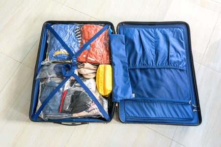 pack the luggage bag for Save Space 스톡 콘텐츠