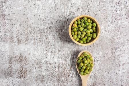 dried Sugar Peas in wood bowl.top view