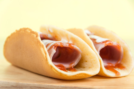 pancakes with ham on wood plate Stock Photo