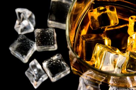 whiskey with ice cubes on Black background Stock Photo
