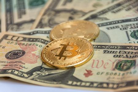 golden bitcoin coin on us dollars .Digital Money and Bitcoine Concept Stock Photo