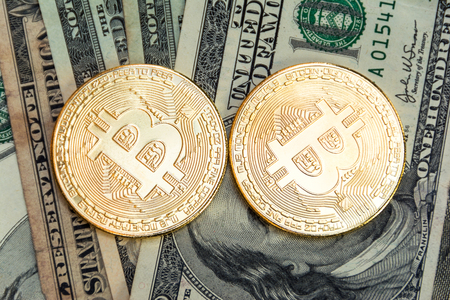 symbolic coins of bitcoin on banknotes dollars.Digital Money and Bitcoine Concept Stock Photo