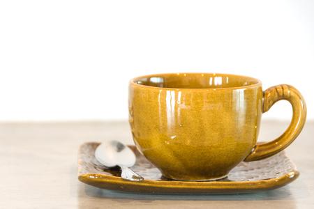 brown mug of coffee