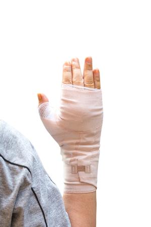 Injured female hand wrapped with bandage