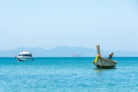 Traditional Thai Longtail boat with speed boat in Andaman Sea at Krabi Province, Thailand.Boat travel Stock Photo