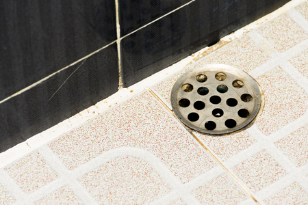 old sewer cover in bathroom Stock Photo