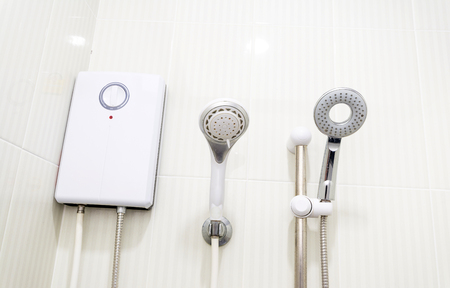 water heater and shower in a bathroom Stock Photo