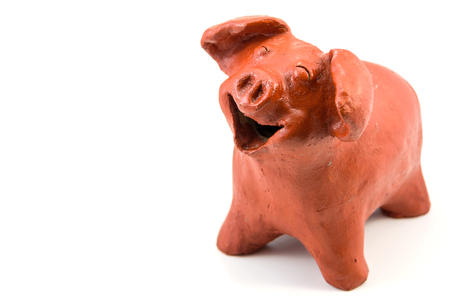 Smile Pig Baked Clay Doll on white background