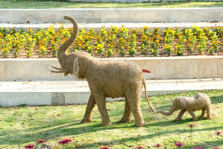 Straw elephant family in the park Stock Photo