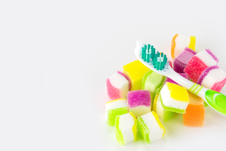 Toothbrush and candy on white background.Dental Care Concept