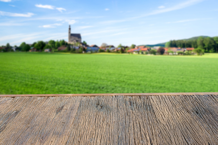 wood Terrace with green field ,wooden table and background blurred
