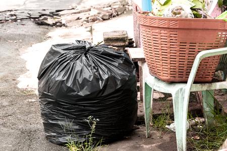 Black plastic garbage bags on the floor
