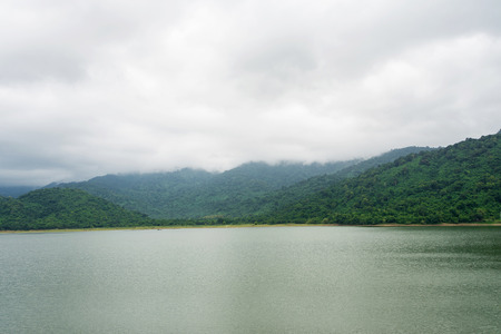 Rainy skies over mountains and lake Stock Photo