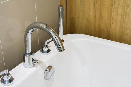 bathtub and faucet in  modern bathroom