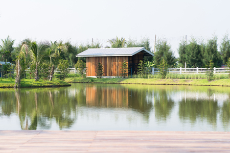 Wooden house near the pond