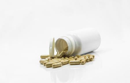 herbal medicine Capsule out of a bottle