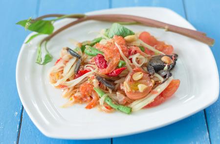 papaya salad with salted crab on white dish Stock Photo