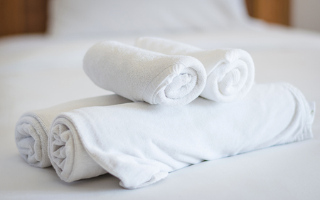 stack of towels on bed decoration in bedroom Stock Photo