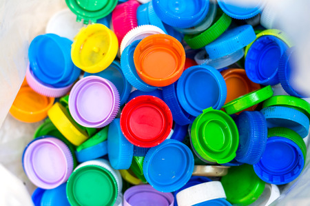 Colorful Plastic bottle caps in garbage ,plastic recycle