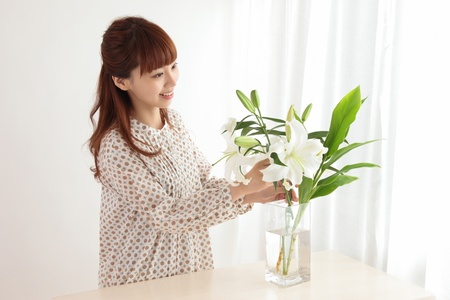 scents: Beautiful young Asian woman with flowers