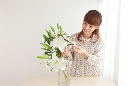Beautiful young Asian woman with flowers photo