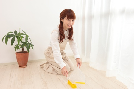 Young Asian woman with a broom to clean up Stock Photo - 11322728
